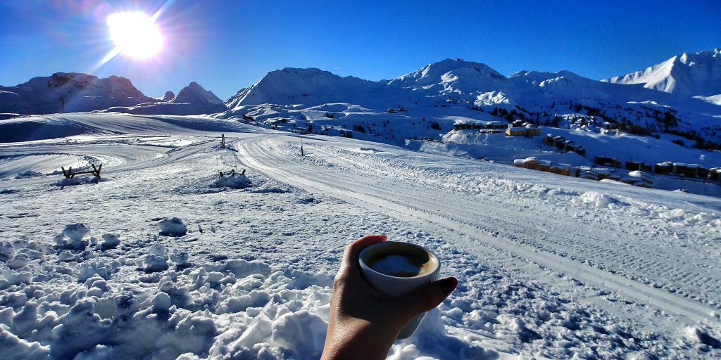 A cup of coffee among the snow white scenery