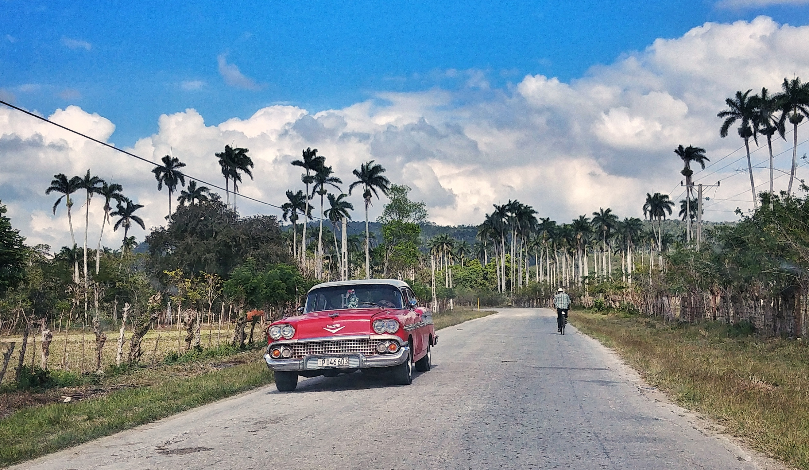 Road in Cuba with a vintage red car
