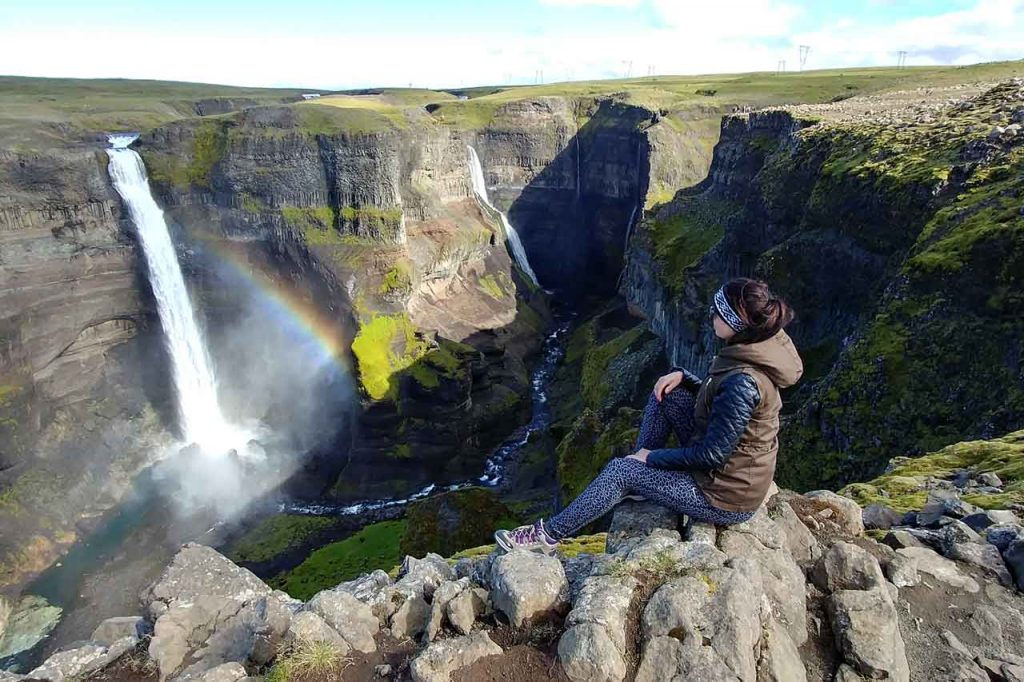 Rainbow appears on the waterfall in Iceland