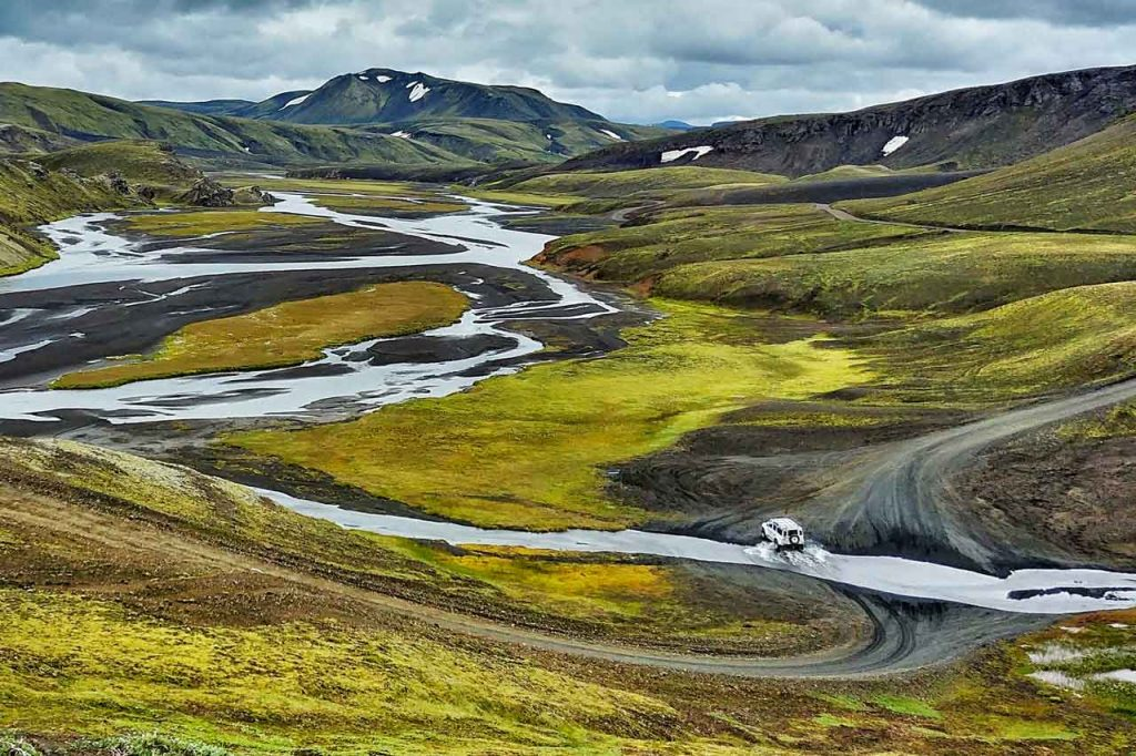 Landscape with car passing through a ford in Iceland