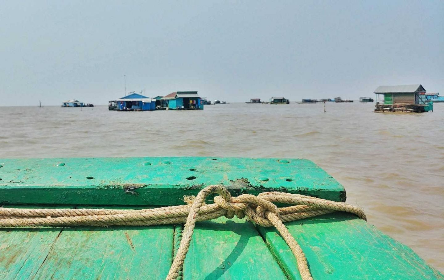 A view from the green boat overlooking the floating houses on the river