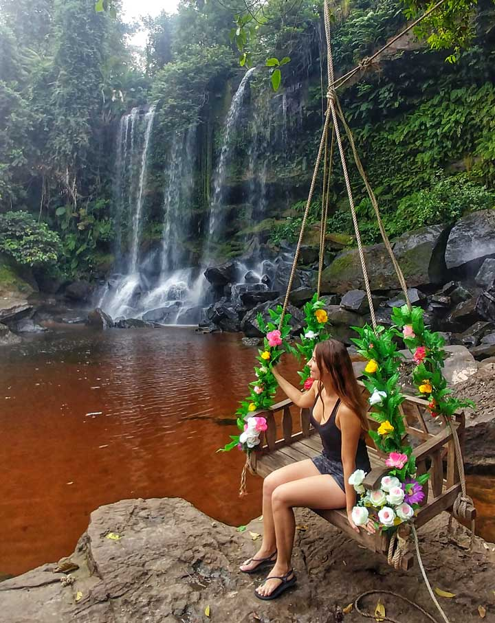 Sitting on a swing by the Phnom Kulen waterfall
