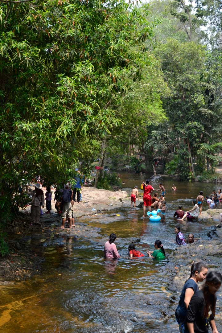 Cambodian people swimming in the river