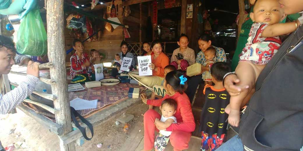 Rural Cambodian women and their babies sitting on a veranda