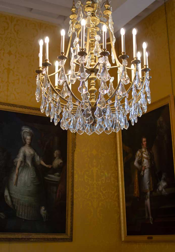 Chandelier and royal paintings in Chateau Chambord