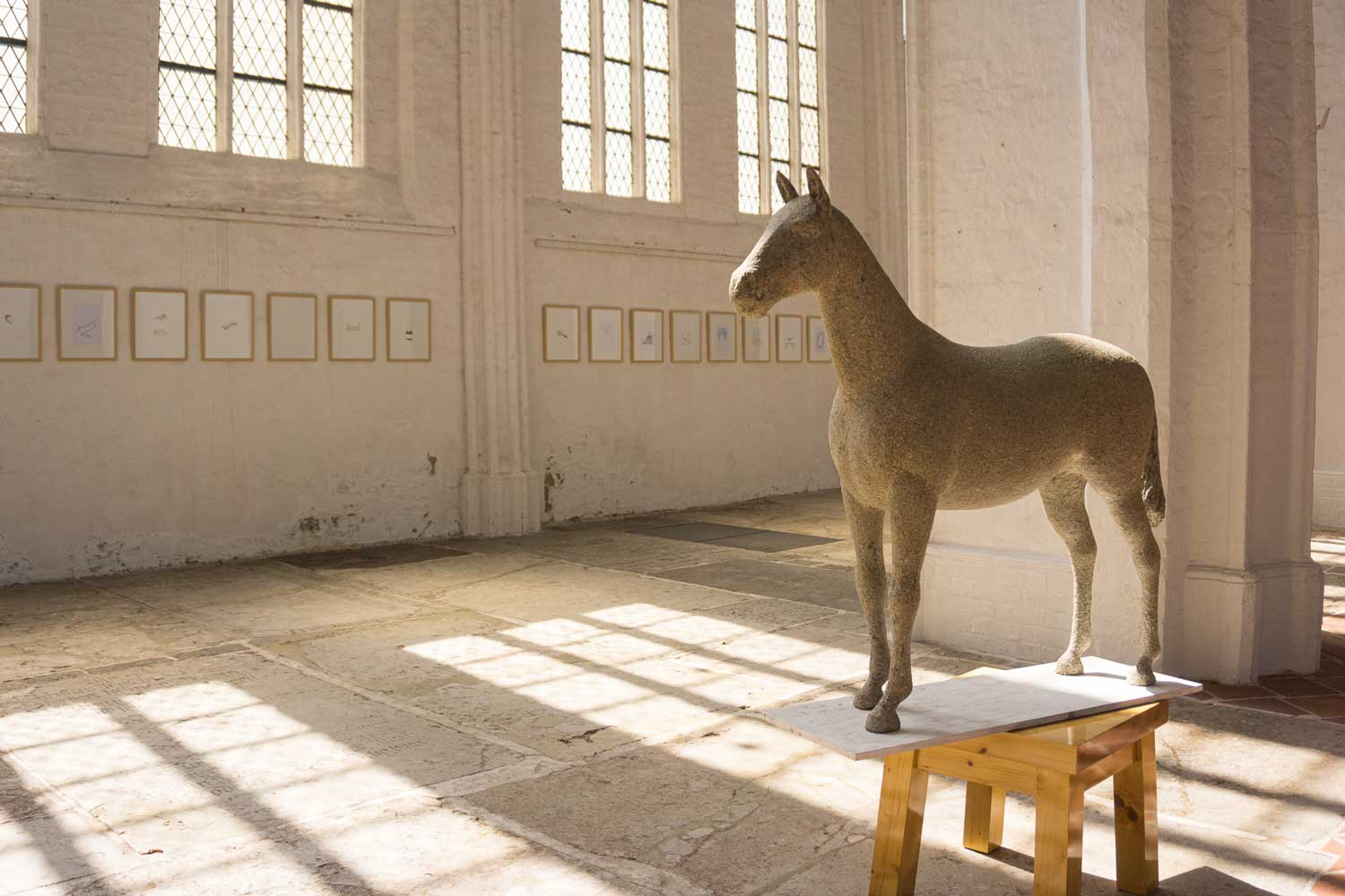 Statue of a horse inside a museum in Lubeck