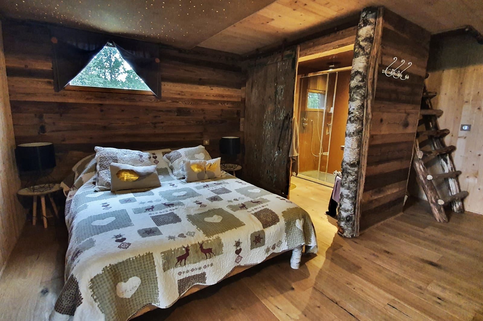 Bed in a wooden tree hut